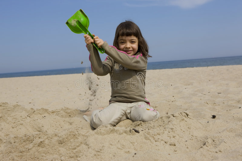 Baby girl. Beautiful baby girl on the beach royalty free stock photography