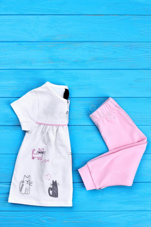 Baby-girl adorable cotton clothes. Top view of new beautiful cotton apparel for little girls, copy space, top view. Toddler girl summer fashion wear royalty free stock photography