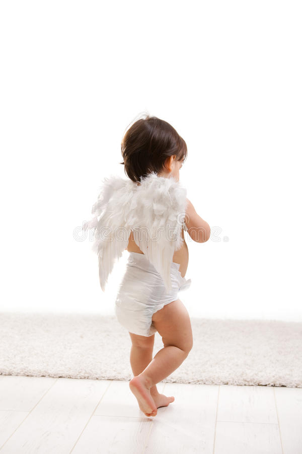 Baby girl with angel wings royalty free stock photos