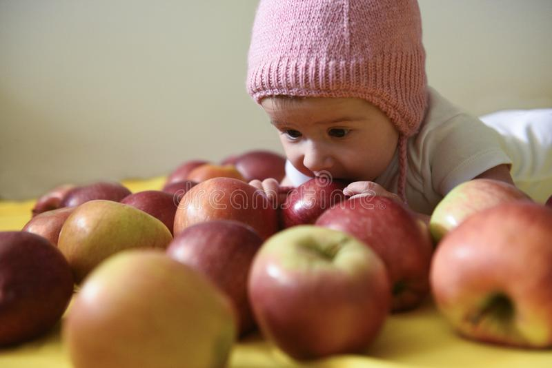 Baby girl and apples royalty free stock photos
