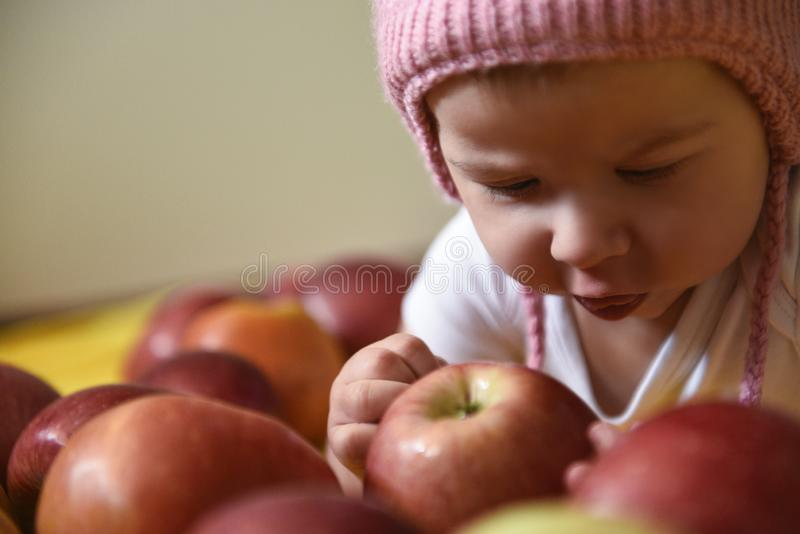 Baby girl and apples royalty free stock image