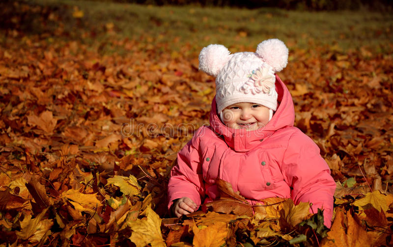 Baby girl in autumn park royalty free stock image