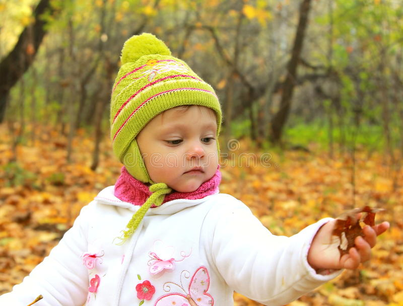 Baby girl in autumn yellow forest royalty free stock photo
