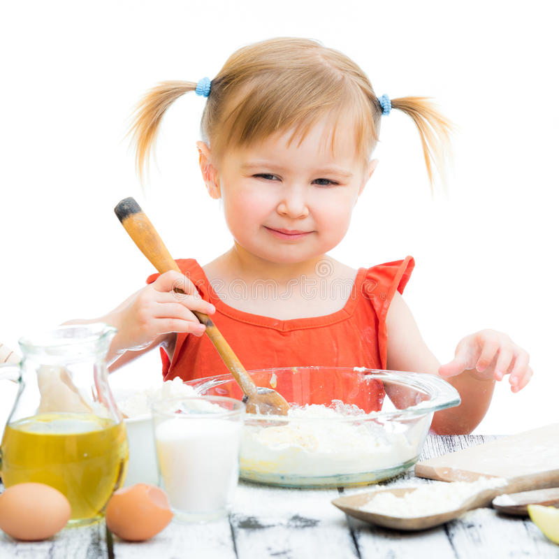 Baby girl baking. Funny little baby girl baking isolated on a white background stock photos