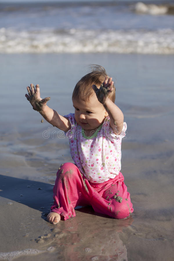 Download Baby girl at beach stock photo. Image of surf, toddler - 16804526