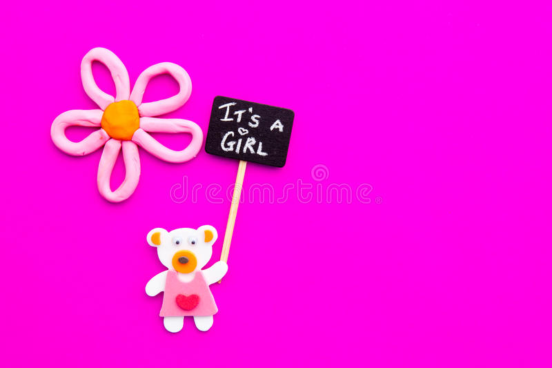 Baby Girl - bear and flower on pink background with It`s a Girl blackboard sign stock photo