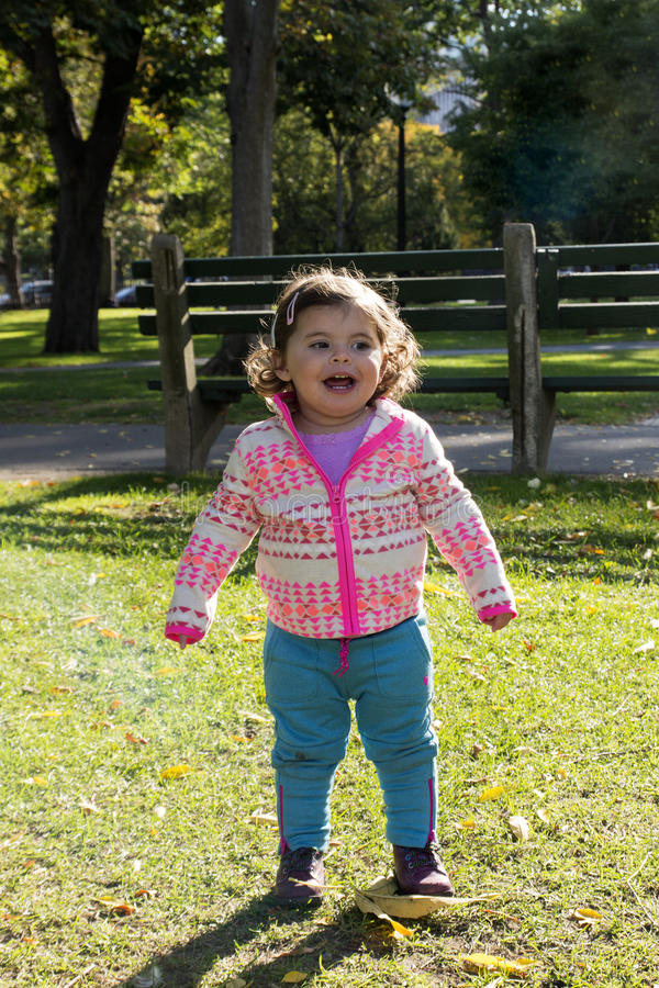Baby Girl in Beautiful Park in Autumn. Baby Girl in Beautiful Boston Common Park, MA stock image
