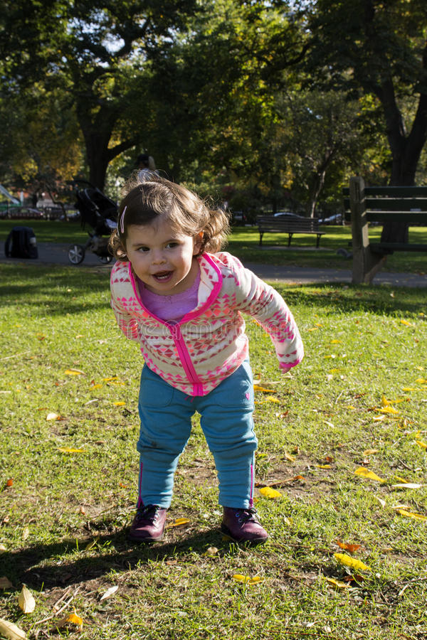 Baby Girl in Beautiful Park in Autumn. Baby Girl in Beautiful Boston Common Park, MA royalty free stock photography