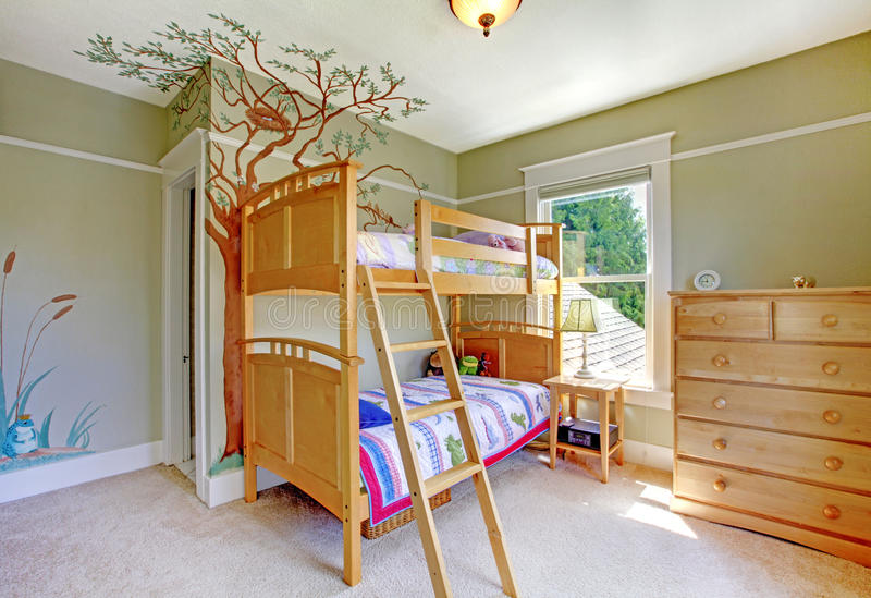 Baby girl bedroom with double bulk bed. Light wood furniture royalty free stock photos