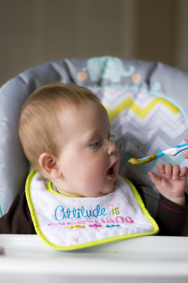 Free Baby Girl Being Fed Stock Photos - 84136093
