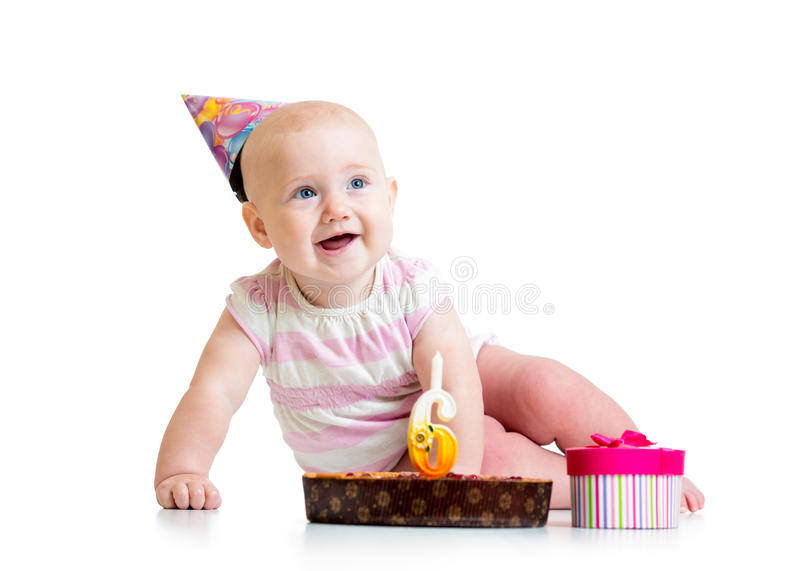 Baby girl with birthday cake royalty free stock images