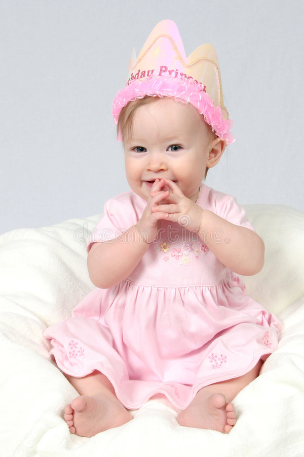 Baby Girl With Birthday Hat an. Little Baby Girl in Pink dress and birthday hat and hands together royalty free stock photos