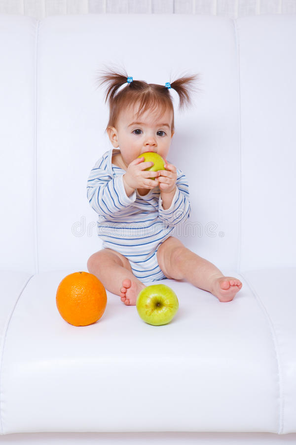 Download Baby girl biting an apple stock image. Image of beautiful - 19069341
