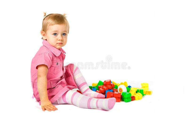 Baby girl with blocks stock images
