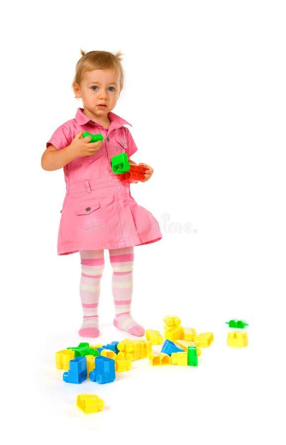Baby girl with blocks stock photo