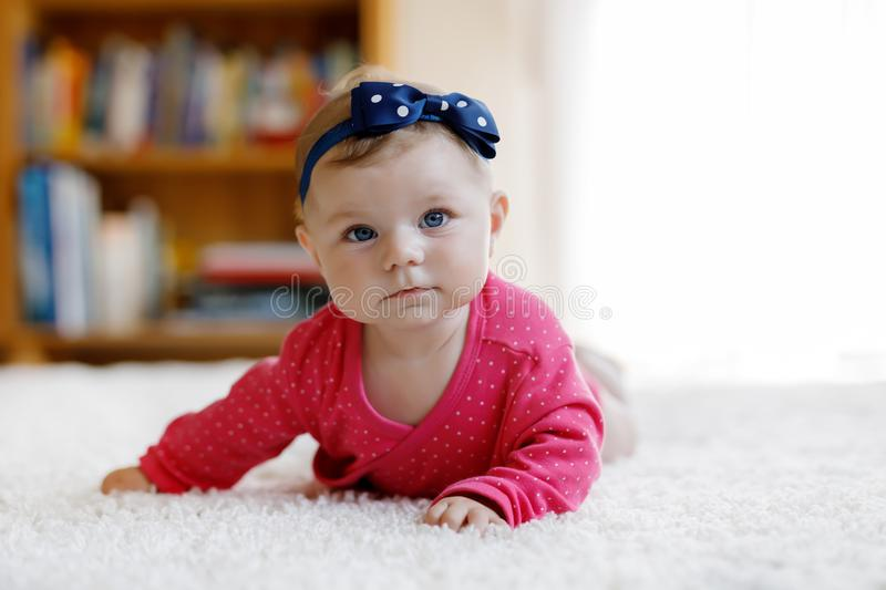 Portrait of little tiny baby girl of 5 months indoors at home royalty free stock image