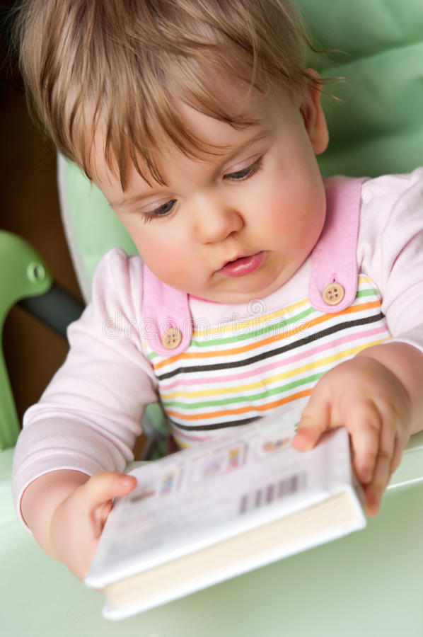Download Baby girl with book stock image. Image of learn, sitting - 18254079