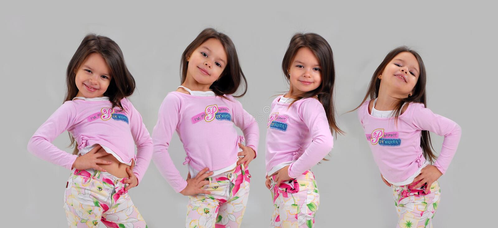 Baby girl in brightly colored clothes royalty free stock photo