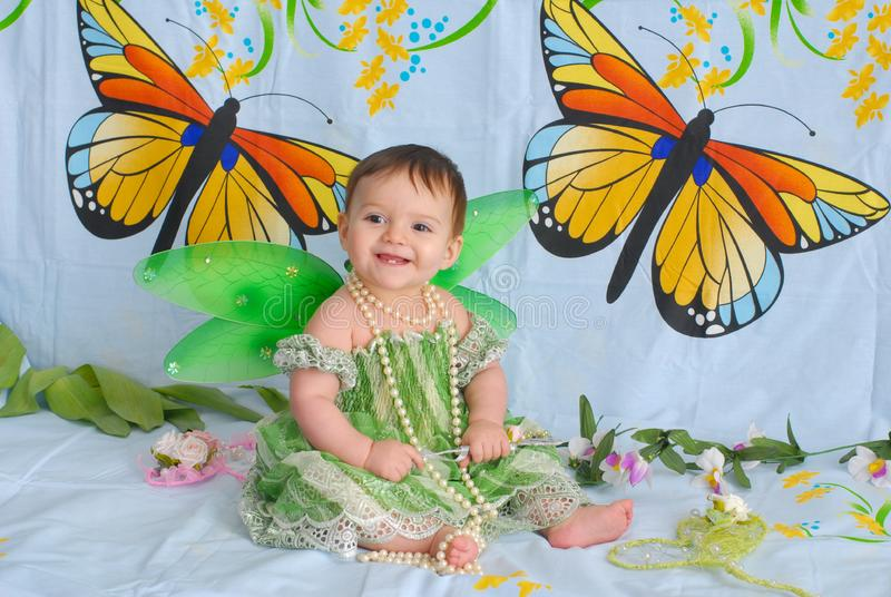 Baby girl with butterfly wings royalty free stock photography