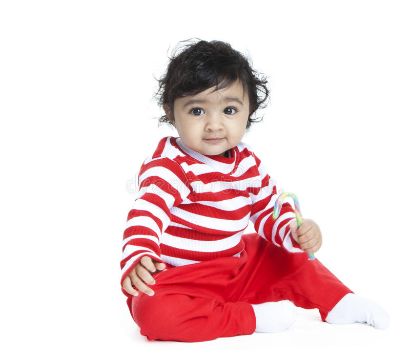 Baby Girl with Candy Cane. Isolated, White royalty free stock photo