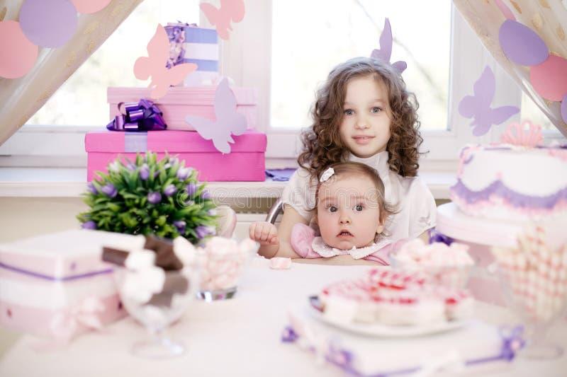 Baby girl celebrating first birthday royalty free stock photo