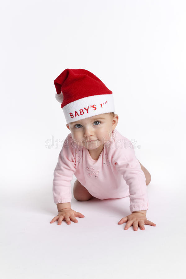 Baby girl with christmas hat stock photo