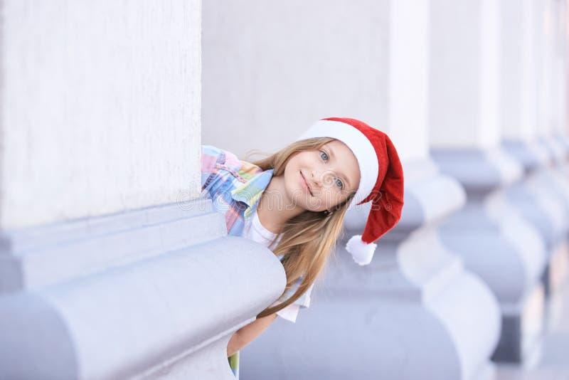 Baby girl at christmas hat. Outdoor santa happy beaty portrait stock image