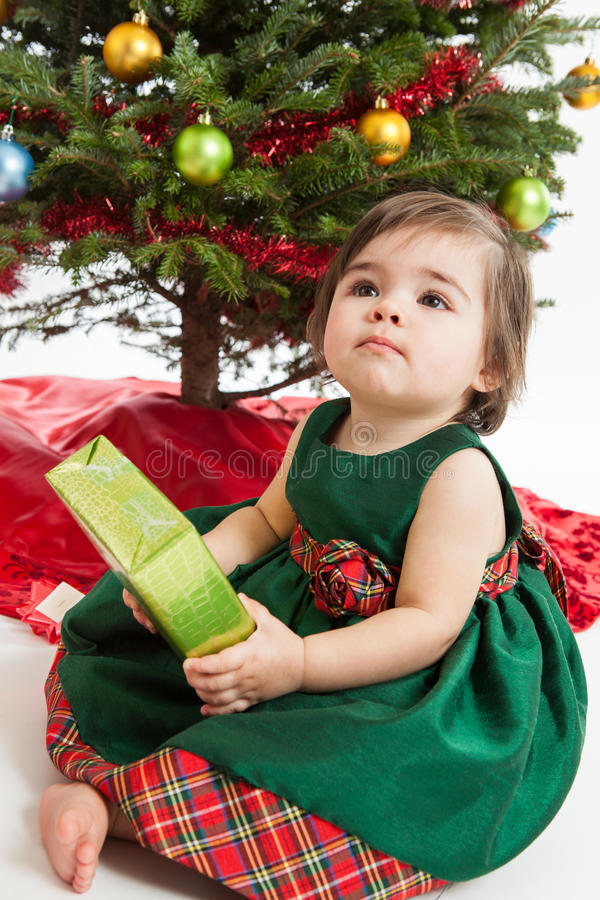 Baby girl with Christmas present stock photo