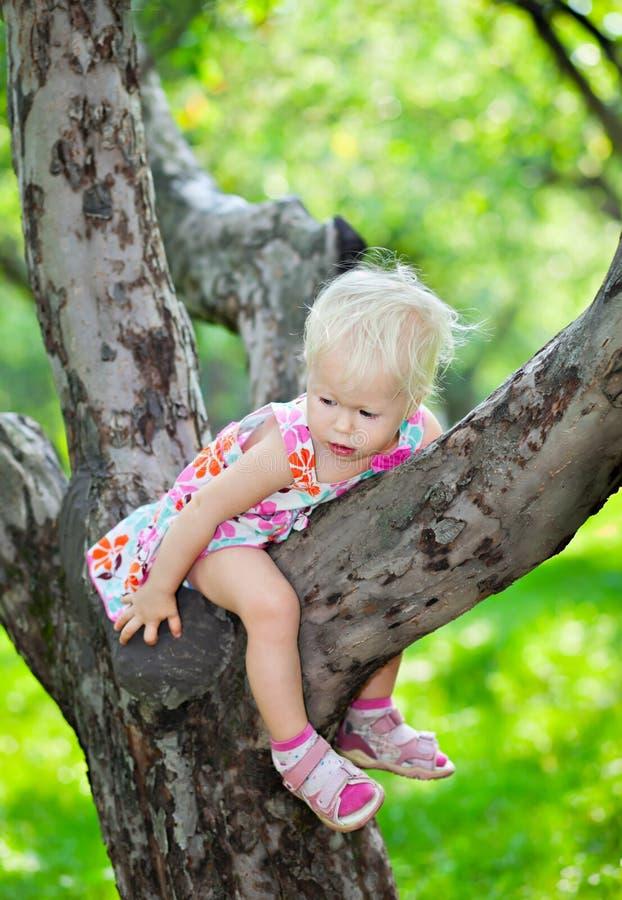 Baby girl climbing royalty free stock photography