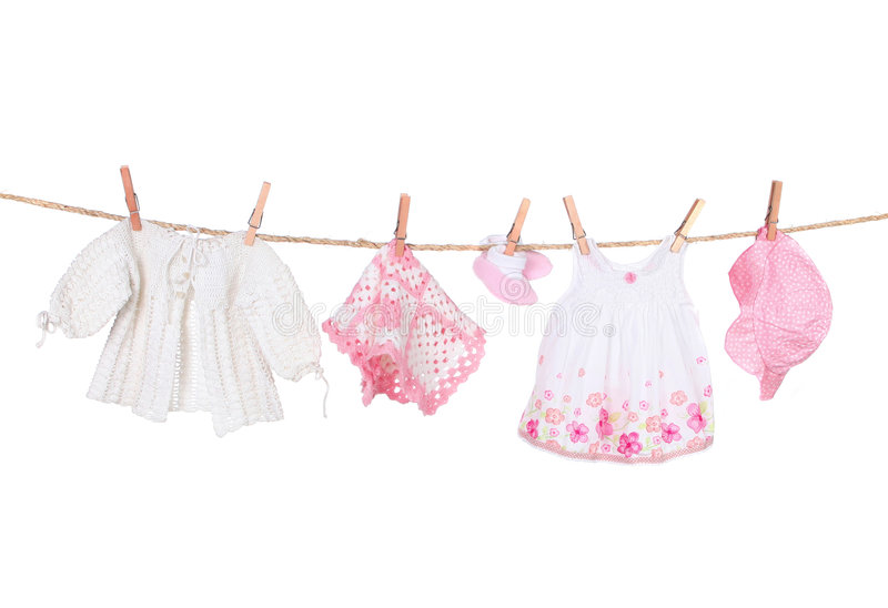 Baby Girl Clothing Hanging on a Clothesline. Isolated on White Background royalty free stock image