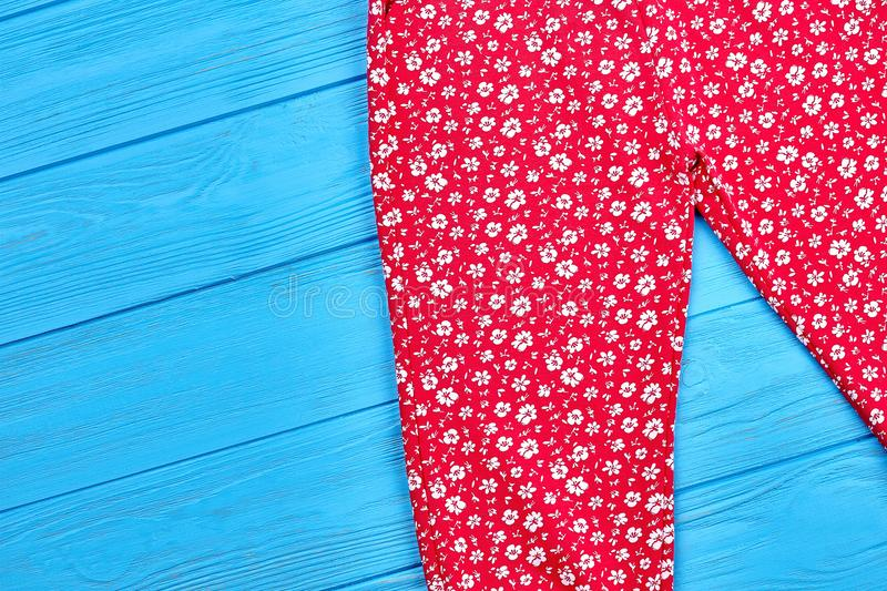 Baby girl colored patterned trousers. royalty free stock images