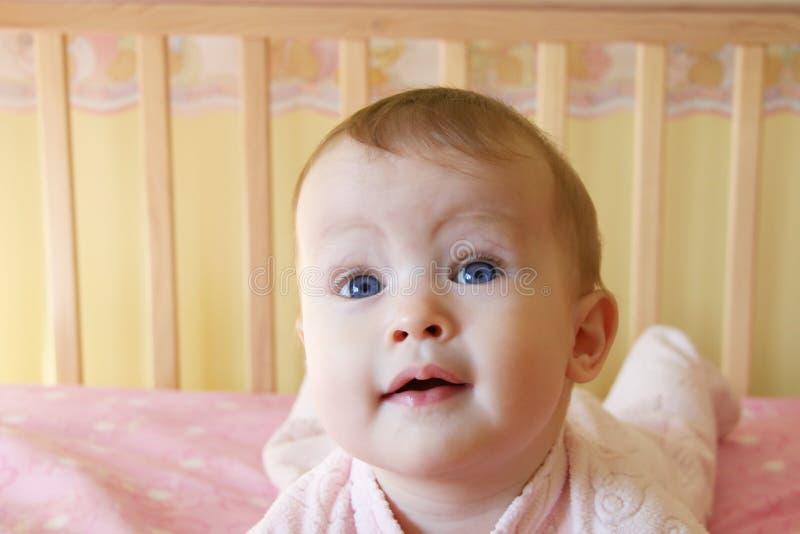 Baby Girl in Crib stock image