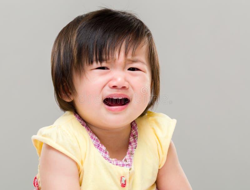 Baby girl crying stock image