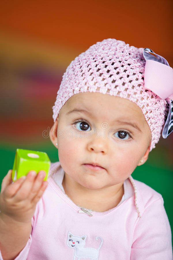 Baby girl with a cube stock photography