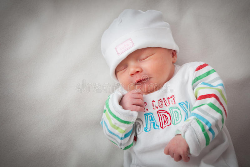 Download beautiful newborn baby girl sleeping with her han stock photo image of brightly