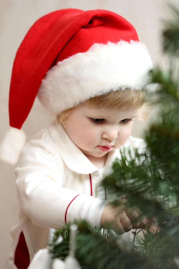 Free Baby Girl Decorate The Christmas Tree Royalty Free Stock Image - 30447116