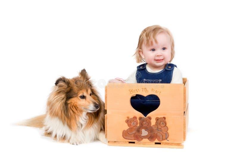 Baby girl and dog stock image