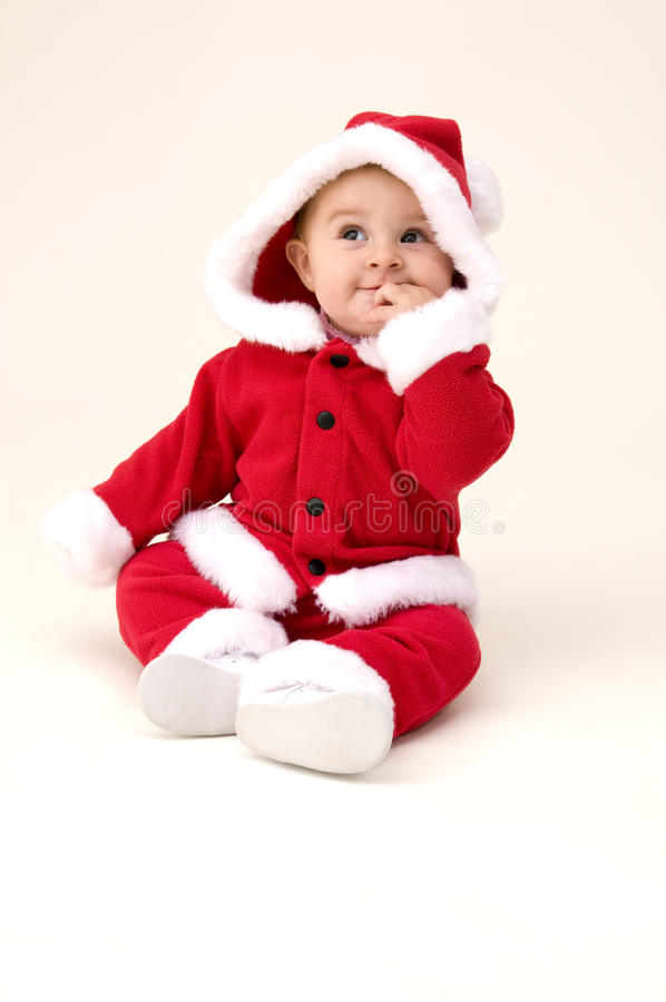 Baby Girl Dressed Up in Santa Costume royalty free stock image