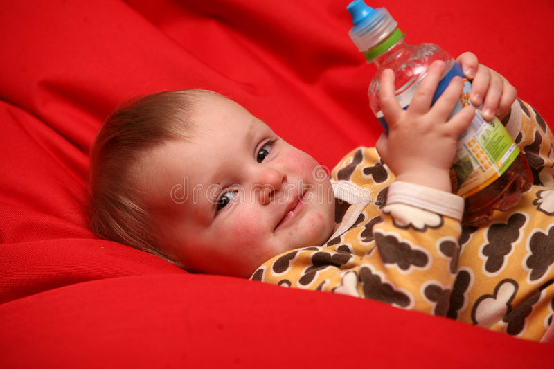 Baby girl drinking stock photography