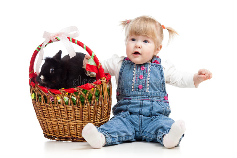 Baby girl with Easter bunny stock images