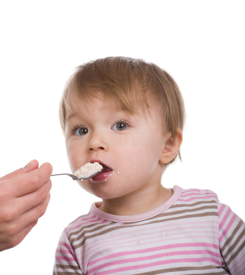 Download Baby girl eating stock image. Image of isolated, daughter - 8268111