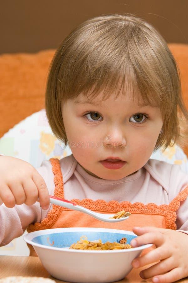 Baby girl eating royalty free stock image