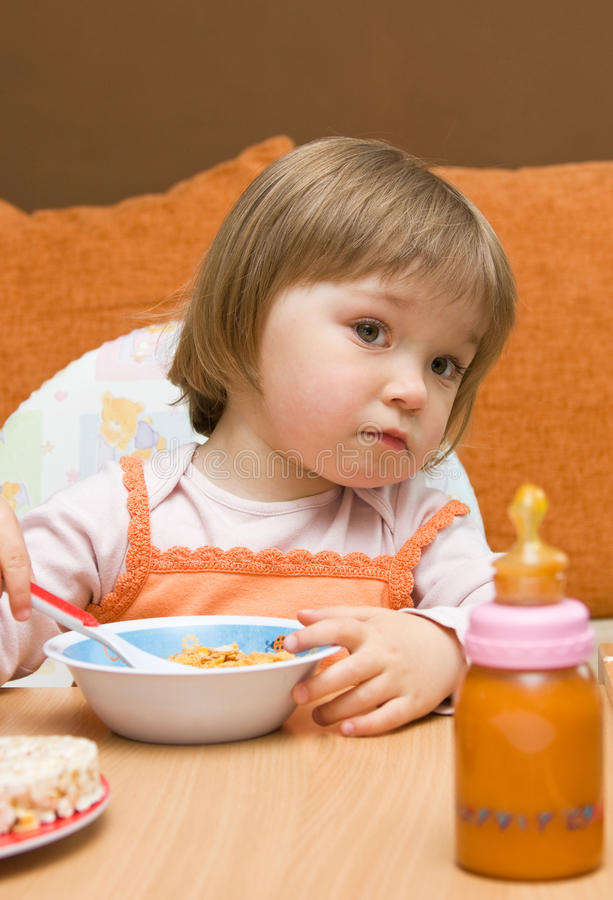 Baby girl eating royalty free stock images