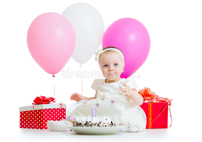 Baby girl eating birthday cake. Cute kid girl eating birthday cake royalty free stock photo