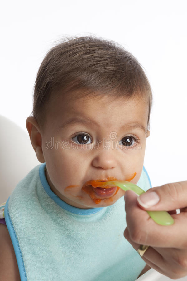 Download Baby Girl Is Eating Carrots From A Spoon Stock Photo - Image: 11977510