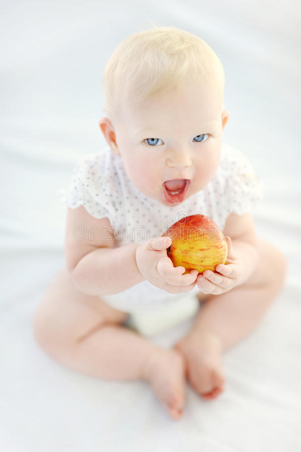 Baby girl eating healthy food royalty free stock photography