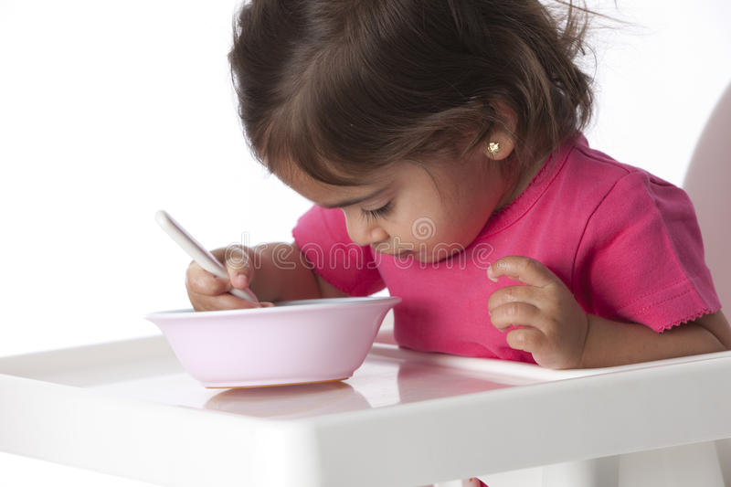 Download Baby Girl Is Eating By Herself Stock Image - Image: 11977487