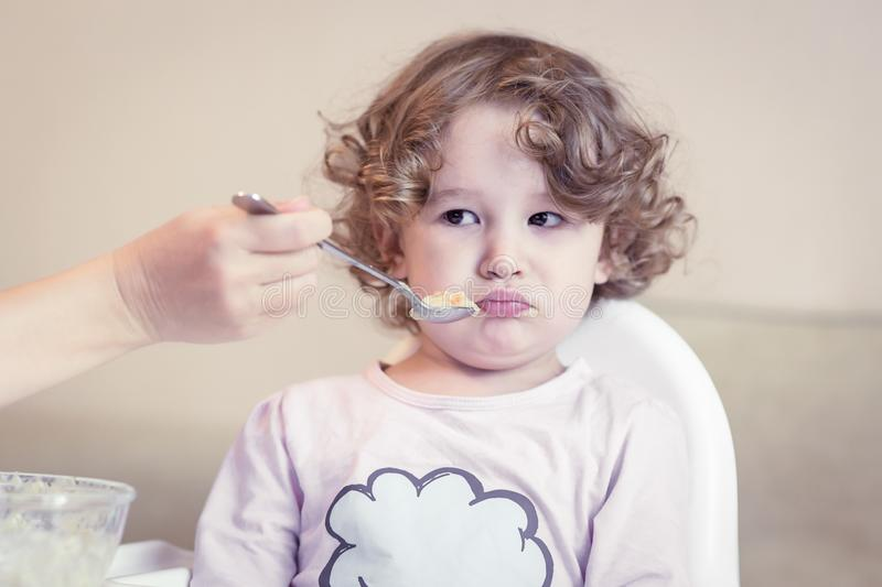 Baby girl during eating at home royalty free stock photo