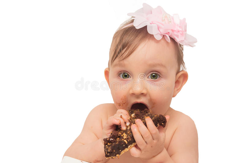 Baby girl eating stock photos
