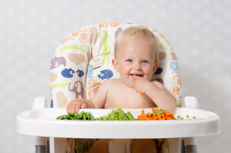 Download Baby girl eating raw food stock image. Image of carrot - 58002199
